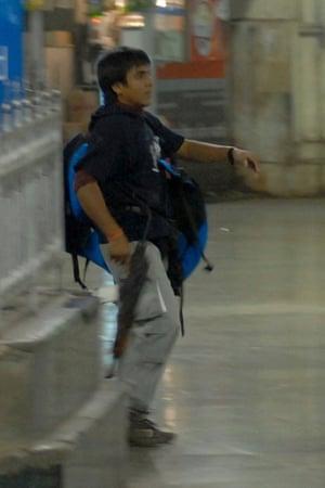 A gunman walks through Chhatrapati Shivaji Terminus on 26 November, 2008.