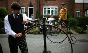 Cyclists prepare their penny-farthings for the Great Knutsford Penny Farthing Race.