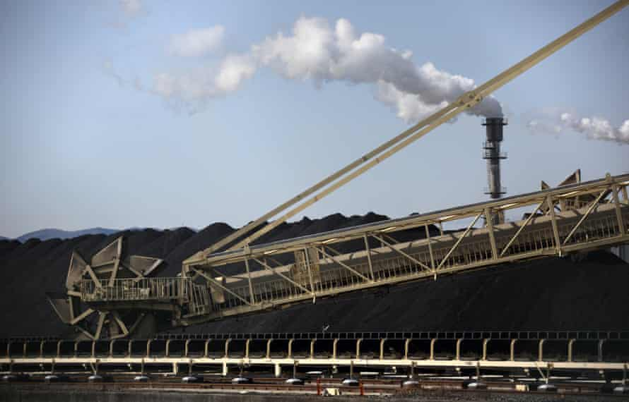 A bucket wheel reclaimer stands on a coal stockpile site at the Onahama port of Iwaki City, Fukushima Prefecture, Japan, on Friday, Feb. 7, 2014. With the loss of nuclear plants, which produced more than 25 percent of Japan's electricity before the disaster, the country have had to rely on oil, coal and gas-fired plants. The cost of importing those fuels has driven the country into a trade deficit for 18 straight months while the current-account shortfall widened to a record in November.