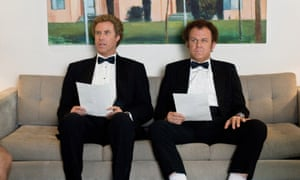 Will Ferrell and John C Reilly sitting on a coach wearing tuxes before their job interview in Step Brothers.