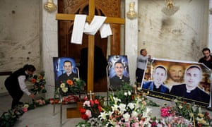 Photographs of slain Iraqi priests at a church in Baghdad