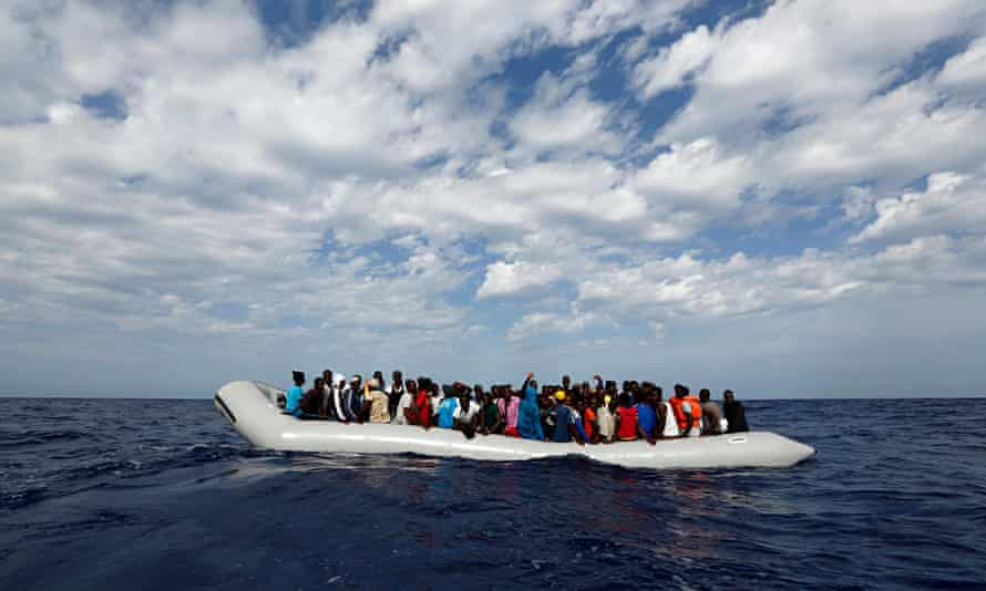 A dinghy packed with migrants off the Libyan coast