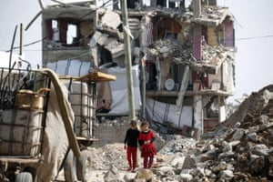 Palestinian girls walk past the rubble of a heavily damaged building in Shejaiya, which was destroyed during the 50-day war between Israel and Hamas militants last year. Israel killed more Palestinian civilians in 2014 than in any other year since the occupation of the West Bank and Gaza Strip began in 1967, according to a UN report