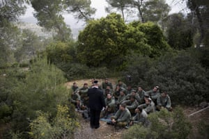 Moshe Eshkenazi tells Israeli border officers the story of his grandfather, Moshe Pesach, during a ceremony marking Holocaust remembrance day in the Martyr's forest near Moshav Kesalon. His grandfather, who was rabbi of the Jewish community in Volos, Greece, during the second world war, saved more than 1,000 Jews