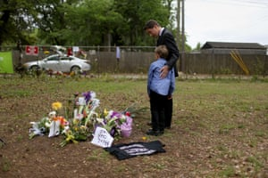 Rev Jeremy Rutledge and his son look at a memorial built on the site where Walter Scott was killed by a police officer in North Charleston, South Carolina. Scott was shot by officer Michael Slager, who now faces murder charges. Slager is also one of three patrolmen named in a lawsuit filed by Julius Wilson, who says he was shot with stun gun while lying face down on the pavement