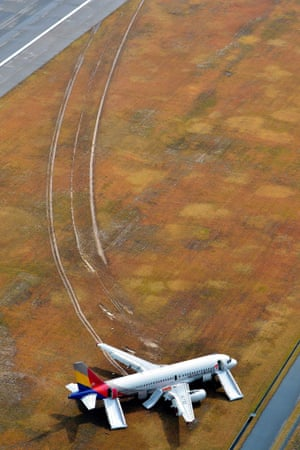 An Asiana Airlines aircraft, which skidded off the runway, is photographed at Hiroshima airport, Japan. The aircraft struck a communications tower as it came in to land, leaving dozens of passengers with minor injuries