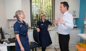 Prime Minister David Cameron meets nurses at the health centre.