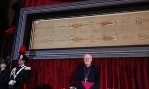 Archbishop of Turin, Cesare Nosiglia, in front of the Turin shroud during a preview on Saturday.