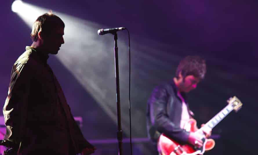 Liam and Noel Gallagher perform live in Germany in July 2009, the month before the band's split.