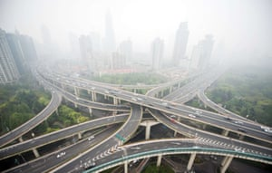 Shanghai, China Smog hangs over the city as cars pass through the Nine Dragon intersection