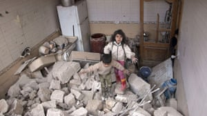 Aleppo, Syria Children emerge from the remains of their home which was damaged during a reported airstrike by government forces
