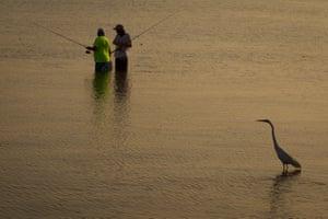 St. Petersburg, US Anglers fish in Tampa Bay