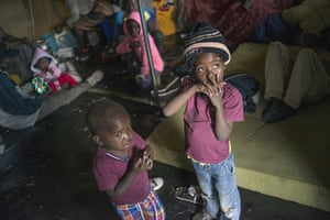 Primrose, South Africa The children of foreign nationals look out of a tent housing refugees fleeing the recent a wave of xenophobic violence against immigrants