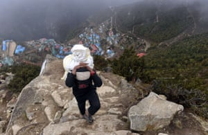 Namche Bazar , Nepal A teenager working as a porter carries sacks of flour up a hillside