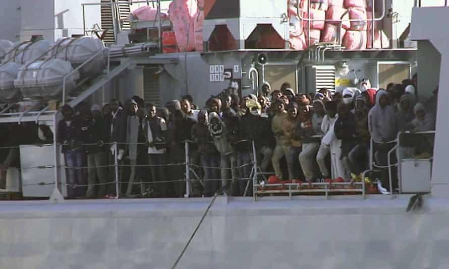 Migrants aboard an Italian navy vessel approaching the Italian port of Messina on Saturday.