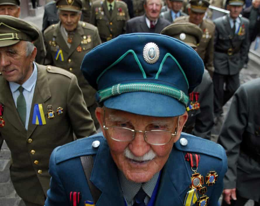 Veterans dressed in historical uniforms of the Ukrainian Insurgent Army (UPA) march to celebrate Heroes Day.
