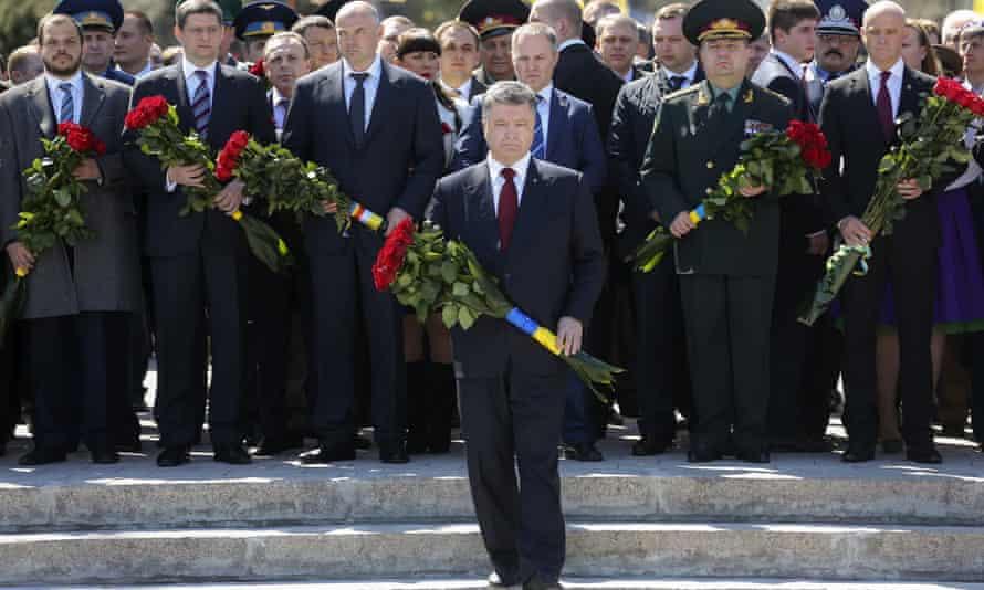 Ukrainian president Petro Poroshenko lays flowers at a memorial to the unknown sailor in Odessa.