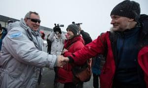 Russia's deputy prime minister, Dmitry Rogozin, left, at the airport in the settlement of Longyearbyen.