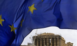 The European Union flag waves in front of the Parthenon Temple on Acropolis Hill in central Athens, Greece.