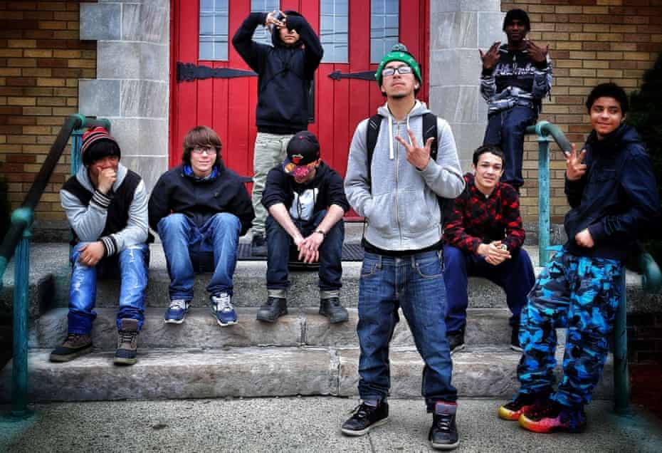 Newburgh teenagers on a break from school flash gang signs.