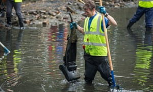 Volunteers clean up a stretch of Regent's canal near Salmon Lane lock, London.