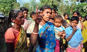 A Santhal tribal woman speaks to journalists in connection with the gang rape in Subalpur village in West Bengal.