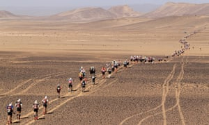Competitors in the valley of Rich Merzoug during the Marathon des Sables.