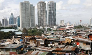 Slums with the skyline of Makati, the financial district, in Manila