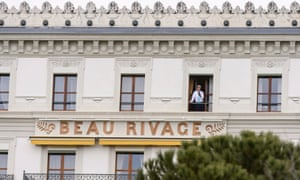 The US secretary of state, John Kerry, at a window of the Beau Rivage Palace hotel, where the nuclear talks with Iran are taking place.
