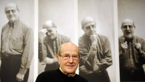 Manoel de Oliveira poses in front of a wall announcing an exhibition on his work at the Akademie der Kuenste (Academy of Fine Arts) in Berlin, 2009