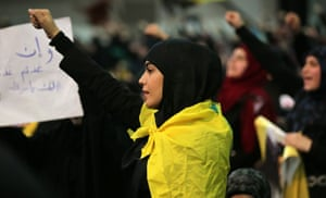 A Shia supporter shouts slogans during a Hezbollah meeting in Beirut.