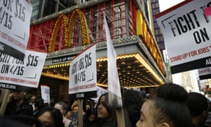 People participate in rally in front of a McDonalds in New York, Tuesday, March 31, 2015. Fast-food labor organizers say they're expanding the scope of their campaign for $15 an hour and unionization, this time with a day of actions including other low-wage workers and demonstrations on college campuses. (AP Photo/Seth Wenig)