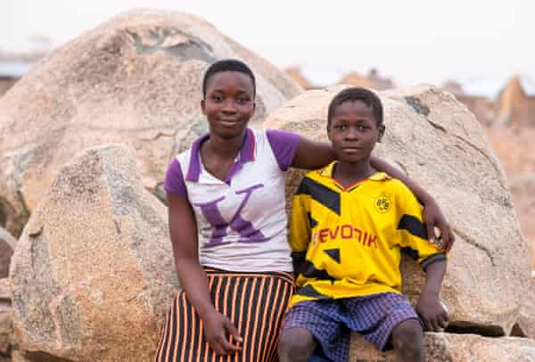 Cecilia Abanga and her brother Ayabil, who does not go to school because there is no money to send him