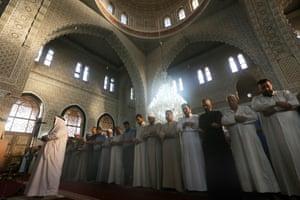 Iraqi Sunni Muslims perform prayers in the capital Baghdad.
