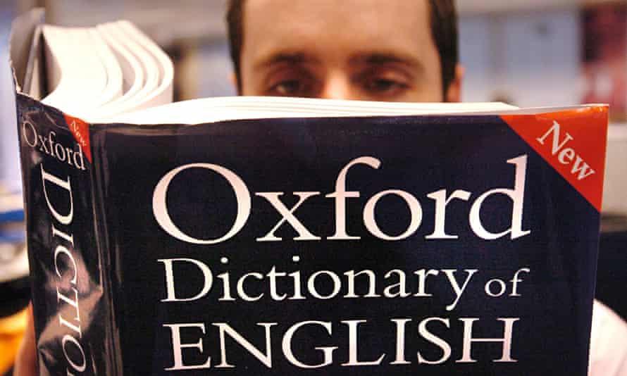 Man reading English dictionary