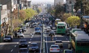 Traffic in Tehran. Iran used to be the 10th largest car and lorry market and is attracting attention from Peugeot, Renault and General Motors.