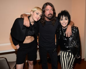 Miley Cyrus, left, with Dave Grohl and Joan Jett  at the 2015 Rock And Roll Hall of Fame ceremony
