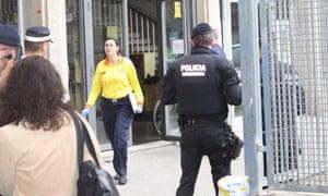 Police outside the Instituto Joan Foster in Barcelona.