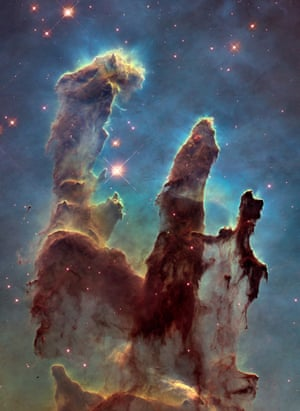 """This is an iconic Hubble image: the so-called """"Pillars of Creation"""". Taken in 1995, the picture revealed never-before-seen details of three giant columns of cold gas bathed in the scorching ultraviolet light from a cluster of young, massive stars in a small region of the Eagle Nebula, or M16."""