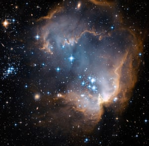 These bright, blue, newly formed stars are blowing a cavity in the centre of a star-forming region in the Small Magellanic Cloud.