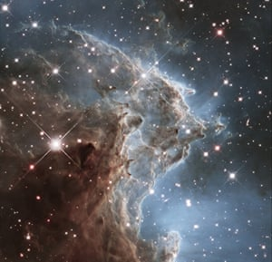 The Monkey Head Nebula is a region of star birth located 6,400 light-years away. This image captures knots of gas and dust silhouetted against glowing gas. Ultraviolet light from massive, newly formed stars is sculpting dust within the nebula into giant pillars.