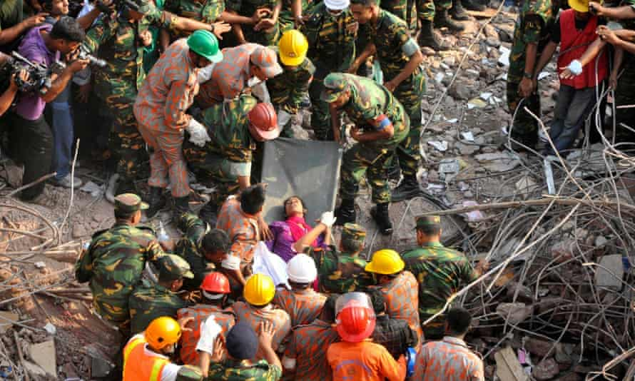 Rescue workers rescue a woman from the rubble of the Rana Plaza building 17 days after the building collapsed in Savar May 10, 2013.