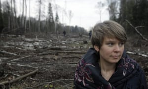 Environmental activist Yevgenia Chirikova stands in a clearing, in the Khimki forest north of Moscow, Russia.