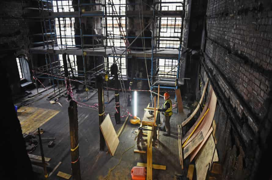 Builders at work in the Glasgow School of Art Mackintosh Library on February 11, 2015 in Glasgow, Scotland.