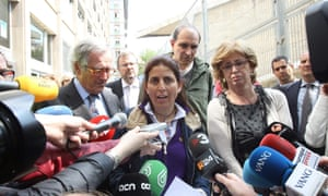 Instituto Joan Fuster's principal, Dolors Perramon (centre) speaks to reporters next to Barcelona's mayor, Xavier Trias (left), and Catalan regional education minister, Irene Rigau.