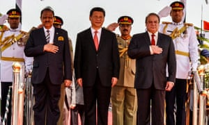 President Xi Jinping flanked by Pakistani president  Mamnoon Hussain (L) and prime minister Nawaz Sharif (R) at Islamabad airport on Monday.