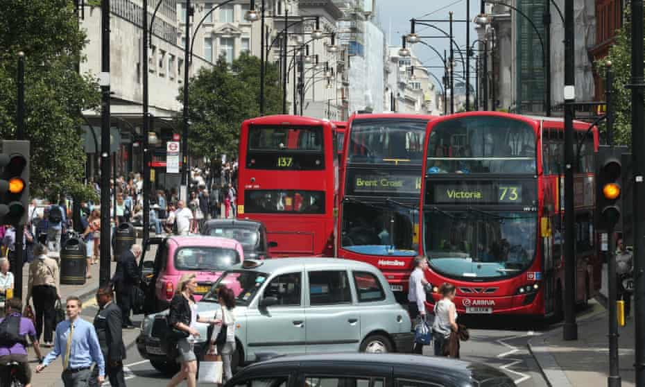 Buses and taxis fill Oxford Street.