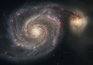 This galaxy is nicknamed the Whirlpool because of its swirling structure. Young stars reside in the curving spiral arms, whereas the yellowish core is the home of older stars.