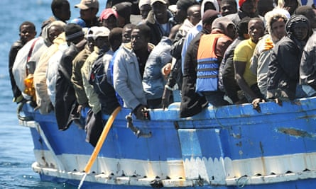 A boat with immigrants on board arrives at Lampedusa, southern Italy.
