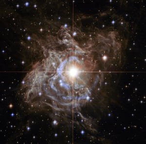 This Hubble image shows RS Puppis, a type of star known as a Cepheid variable. Unusually, this star is shrouded by thick, dark clouds of dust enabling a light echo to be shown with stunning clarity.